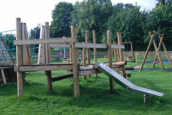 Playscheme climber with slide